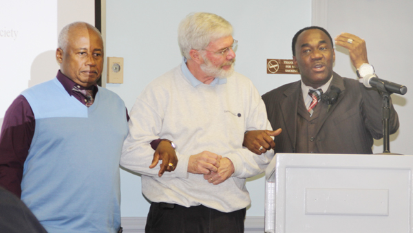 Pastor C. David Stackhouse (right) stresses the importance of unity in strengthening society's relationships as he stands arm-in-arm with Hertford County School Board member David Shields (center) and the Rev. James Shearn, President of Hertford County NAACP. Staff Photo by Cal Bryant