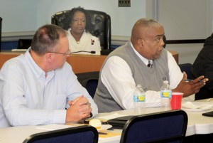 Hertford County Sheriff Juan Vaughan (right) offers a suggestion at Tuesday's meeting in Winton. At left is Murfreesboro Police Chief Darrell Rowe. Staff Photo by Cal Bryant