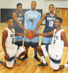Senior members of the Bertie High varsity basketball team model the team's new home (white) and away (blue) uniforms and warm-ups donated to the school from former Falcons player and current NBA pro, Kent Bazemore.  Shown are players (standing, from left) Terrell Bond; Tydre Lee; Archie Wesson; (kneeling, from left) Donte Horton; and Dontae Greer. Staff Photo by Gene Motley