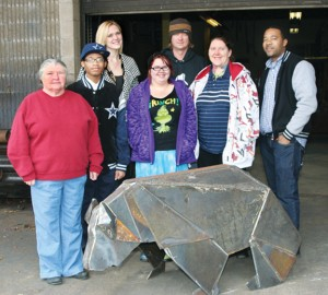Roanoke-Chowan Community College art students and Fine Arts professor Jim Messer pose with a welded replica of the Origami Bear. Tuesday, the Ahoskie Town Council approved placing a large similar sculpture at the Ahoskie Creek Park Recreation Complex. Pictured are (from left) Amy Snipes, Kedrien Manning, Jessica Howerton, Destiny Sandusky, Messer, Dorothy Howell, and welding instructor Marvin Ryan. Staff Photo by Gene Motley