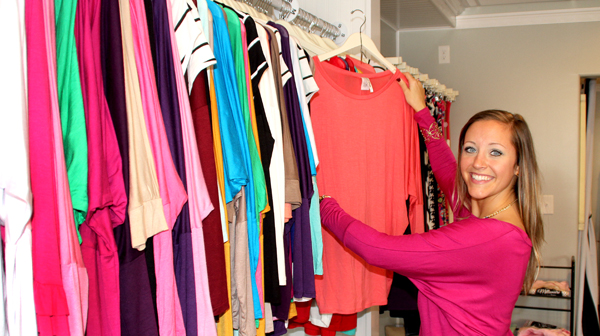 Rebecca Martin displays just one of numerous styles and colors of women's apparel found at her business – the Mini Pearl Boutique. Staff Photo by Cal Bryant