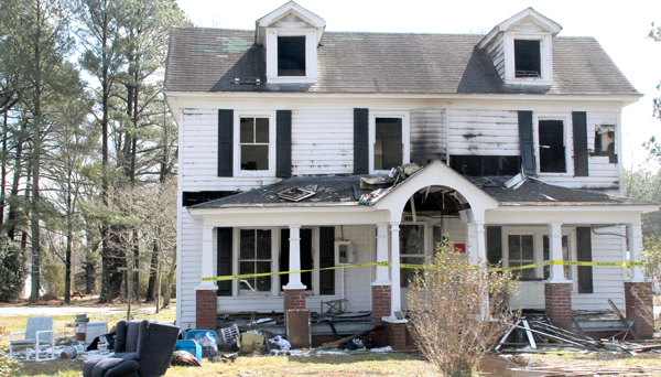 This home at 1310 North Martin Luther King Jr. Drive suffered extensive damage during Sunday's fire. No one was injured. Staff Photo by Cal Bryant