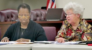 Northampton County Finance Officer Dot Vick (right) explains a portion of the county's proposed 2015-16 general fund budget to the Board of Education at Thursday's meeting. At left is Fannie Greene, chair of the county commissioners. Staff Photo by Cal Bryant