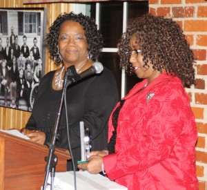 Newly elected Murfreesboro Chamber President Brunet Parker (left) receives a memento from her sister, Jenice Brinkley, marking the significance of Parker being the first African-American female to hold that position since the Chamber's founding in 1953. Staff Photo by Cal Bryant