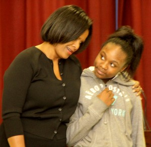 """As part of her visit, Shelia Moses spends a little """"one-on-one"""" time with an AES student. Staff Photo by Cal Bryant"""