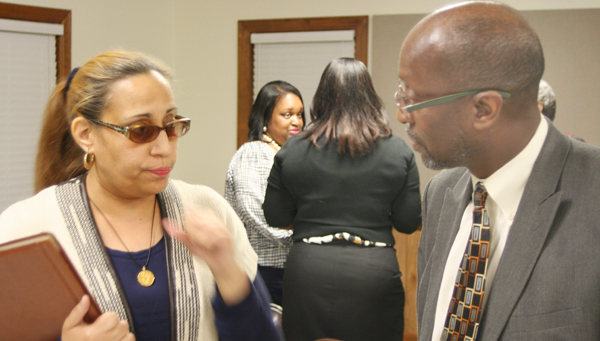 Hertford County Schools Superintendent Dr. Michael Perry meets with Winton Mayor Tiffany Lewis following Thursday's Unity in the Community forum held in Winton. Staff Photo by Gene Motley