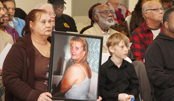 A family member holds a portrait of Shonda Stansbury of Roanoke Rapids, one of six missing individuals from either Halifax or Northampton counties who were remembered Saturday during a prayer vigil held in Jackson. Staff Photo by Cal Bryant