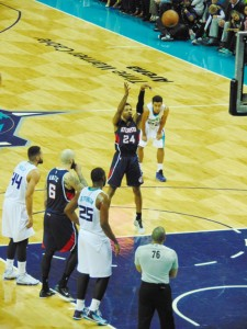 """Kent Bazemore lifts a shot from the free throw line, part of his career-high 20 points while playing in front of a group of local fans who made the trip to Charlotte. Photo by J.W. """"Russ"""" Russell"""