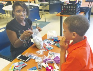 Deonshae Vinson and Jordan Staton were a couple of the elementary and middle school students participating in artworks projects at Maker Faire. Contributed Photo by Addison Hoggard