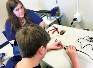 Alyssa Harrell and Colin Vaughan put the finishing touches on their Maker Faire project.  Hertford County educators hope to launch two Maker Faires for students next fall. Contributed Photo by Addison Hoggard