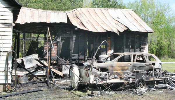 A home near the Bertie-Hertford County line was destroyed by fire on Tuesday. Staff Photo by Gene Motley
