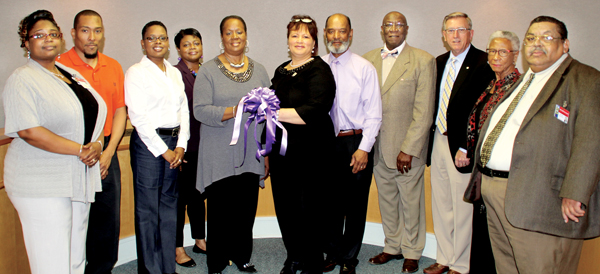 """Northampton County local government officials join with Northampton Relay for Life committee members in promoting the """"Paint the County Purple"""" program. From left are Northampton Manager Kimberly Turner, Relay Committee members Antoine Smith, Laquitta Green-Cooper and Gloria Goode, County Commissioners chairwoman Fannie Greene, Relay Committee members Marla Jerman and the Rev. George M. Jerman Sr. and County Commissioners Robert Carter, Joe Barrett, Virginia Spruill and Chester Deloatch. Staff Photo by Cal Bryant"""