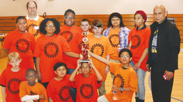 Ahoskie Elementary School students show off their Teamwork Award as earned at the LEGO League Robotics competition. Team coach Gonzalo Pitpit is shown standing, far right. Staff Photo by Gene Motley