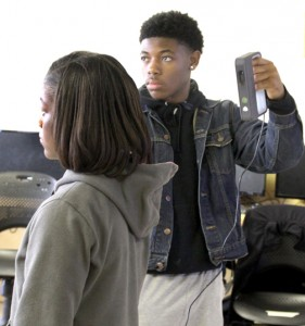 To begin the process of creating a 3D image, the subject matter must first be scanned, which is shown here between STEM students Beirra Sutton and Deshawn Majette. Staff Photo by Cal Bryant