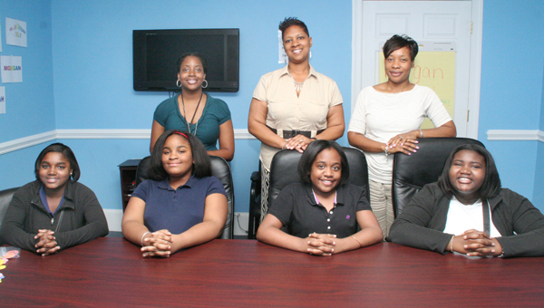 The rookie class at Fiona's House are, seated from left, Nyasiah Parker, Brianna McCullough, Morgan Chadwick and Jabria Lassiter. They are joined here by their adult mentors, standing from left, Jacquesha Harrison, Jaime Heckstall, and Natasha Holley. Staff Photo by Cal Bryant
