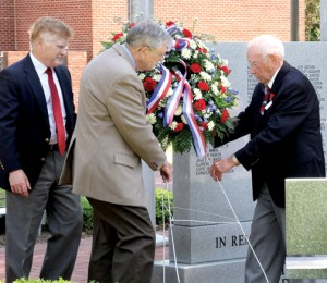 From left, Murfreesboro military veterans Doug Deets, Brinson Paul and Joe Dickerson (joined by Dave Farnham – not shown) prepare to lay a memorial wreath at the base of the town's War Veterans Memorial. Staff Photo by Cal Bryant