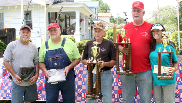 The top-five winning entries at Saturday's R-C Pork Fest in Murfreesboro were, from left, Tommy Turner (4th place), Edgar Hargus (5th), Captain Charlie Meeks (1st), Joe Peterson (2nd) and Amy Whitley (3rd). Staff Photo by Cal Bryant