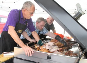 North Carolina Pork Council judges check out the pig cooked by eventual Pork Fest champion Charlie Meeks. Staff Photo by Cal Bryant