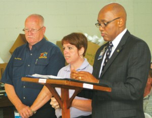 Roanoke-Chowan Community College President Dr. Michael Elam (right) along with RCCC Emergency Services Director, Fred Curley (left), and RCCC Emergency Services Coordinator, Kelly Wiggins (center), addressed the Bertie County Commissioners on the college's EMS/EMT training, CADET and other RCCC programs during the Colerain meeting earlier this month. Staff Photo by Gene Motley