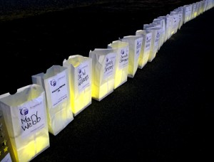 Candle-lit bags, bearing the names of victims and survivors, serve as reminders to the ongoing battle to eliminate cancer. Staff Photo by Cal Bryant