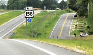 This stretch of the old US 158 (at right) in the Mapleton community has a new name – Tellie Lawrence Road. Staff Photo by Cal Bryant