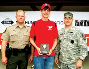 Northeast Academy freshman Joshua Duncan (center) poses with Lt. Mark Rich (left) of the NC Wildlife Commission and Sgt. First Class Bryon Williard (right) of the North Carolina National Guard after winning the Shotgun Shoot-Off event at the 2015 Youth Hunter Education Skills Tournament held April 27 in Ellerbe. Contributed Photo