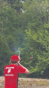 Josh Duncan shoots in the early rounds of the competition. The sporting clays are barely visible in the upper right hand corner. Contributed Photo