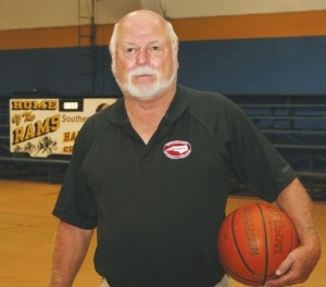 Ridgecroft School athletic director Doug Cobbs poses for one of the last times in the Ridgecroft gym. He coached the basketball teams – boys and girls varsity and girls j.v. – until stepping down in 2008, but remained at the school as its AD. Staff Photo by Gene Motley