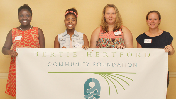 From left, Ty'Niya Banks, Je'Letha Porter and Mayayla Hobbs were the recipients of the M.C. Ashe family scholarship. At right is Bailey Vann, who received the Earl U. Capps Jr. scholarship. Staff Photo by Cal Bryant