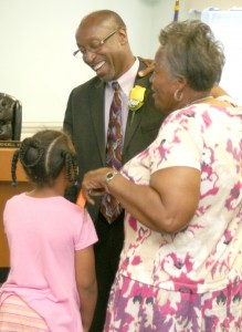 Dr. Perry (center) shares a laugh with a young elementary school student with the New Ahoskie Baptist Church 'Jesus and Me' summer camp along with her counselor, Earlene Davis (right). Staff Photo by Gene Motley