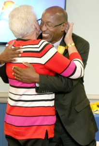 Dr. Perry gets a farewell hug from Chowan University's Dr. Brenda Tinkham who worked with the superintendent when he was beginning his career as a teacher at R.L. Vann School. Staff Photo by Gene Motley