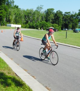 """Windsor residents Kirk Lanier (left) and Meg Sutton (right) pedal the 14 miles around Scotch Hall Preserve for the bike phase of the competition. Photo by JW """"Russ"""" Russell"""