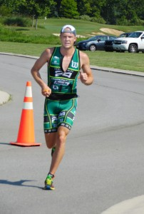 """Men's winner Taylor Jennings of Blacksburg, VA races toward the finish line.  Jennings completed the three-event course in a time of 1 hour-9 minutes-29 seconds. Photo by JW """"Russ"""" Russell"""