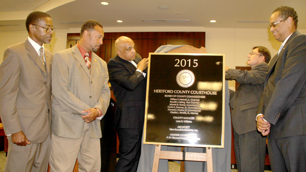 From left, Hertford County Commissioners Garry Lewter, Howard Hunter III (a former commissioner; now State House District 5 Representative), Curtis Freeman, Johnnie Ray Farmer and Bill Mitchell unveil the dedicatory plaque that will be positioned near the front entrance of the new Hertford County Courthouse. Staff Photo by Cal Bryant
