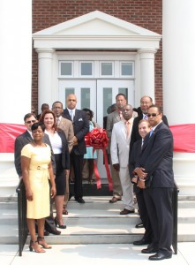 Taking part in Wednesday's ribbon-cutting ceremony that formerly christened the new Hertford County Courthouse were, clockwise from left, Loria Williams, Johnnie Ray Farmer, Valerie Asbell, Garry Lewter, Curtis Freeman, Howard Hunter III, Ronald Gatling, Superior Court Judge Cy Grant, Senior Associate Judge Bob Edmunds of the NC Supreme Court, and Bill Mitchell. Staff Photo by Cal Bryant