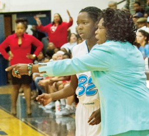 Alice Lyons, shown here with one of her players, has been ousted from her duties as head varsity girl's basketball coach at Bertie High School.  Boy's coach Kelvin Hayes was also released. File Photo