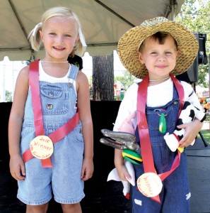 Lena Grace Taylor, daughter of Evan and Mitzi Taylor of Conway, and Jacob Simmons, son of Rye and Melissa Simmons of Conway, respectively captured the titles of Little Miss Farmer and Little Mr. Farmer during Saturday's festivities at the NC Watermelon Festival in Murfreesboro. Staff Photo by Cal Bryant