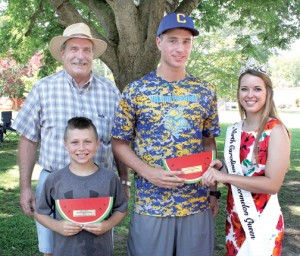The Watermelon Eating Contest winners (by age division) were Austin Jones (front left) of Chesapeake, VA and William Leary (center) of Murfreesboro. Carmen Honeycutt (right), the reigning 2015 North Carolina Watermelon Queen, presented the plaques while Bryon Simonds (back left) managed the annual contest. Staff Photo by Cal Bryant