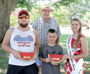 Winners in the Watermelon Festival's Seed Spitting Contest on Saturday are R.J. Neamon (left) of Buffalo, NY and Austin Jones (front center) of Chesapeake, VA. Presenting the awards to the two first place winners is the 2015 North Carolina Watermelon Queen, Carmen Honeycutt of Angier. Bryon Simonds (back) was responsible for overseeing the contest. Staff Photo by Cal Bryant
