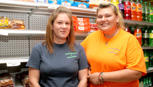 Ashley Lazzara (left) stands with her sister, Karie Roughton, inside the Ahoskie Market….the site of Lazzara's heroic actions last week. Staff Photo by Cal Bryant