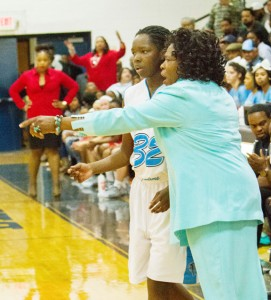 Alice Lyons, shown here with one of her players, has been reportedly ousted from her duties as head varsity girls basketball coach at Bertie High School. File Photo