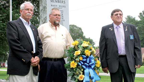 Ruritan Club officials, from left, District Chaplain J.C. Harris, Sunbury President Terry Johnson, and National President Bobby Burton pose after laying a wreath at the Sunbury Ruritan Club monument. Staff Photo by Cal Bryant