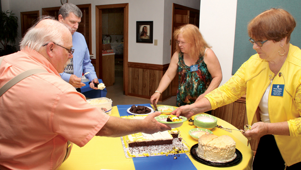Cake and ice cream were two of the popular items on the menu at the Sunbury Ruritan Club's 80th birthday celebration last week. Staff Photo by Cal Bryant
