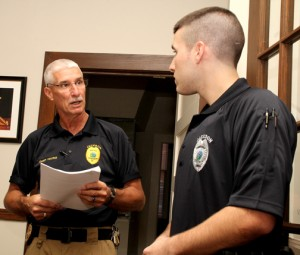 Jackson Police Chief John Young (left) reads the letter of commendation from the Northampton County Sheriff's Office to Jackson Patrol Office Austin Simmons at Wednesday's meeting of the Jackson Town Commissioners. Staff Photo by Cal Bryant