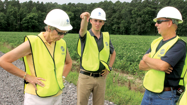 Gates County Commissioners Linda Hofler (left) and Ray Freeman (right) listen as Logan Stephens, Project Development Manager of O2emc, points to an activity now taking place as construction is underway on a solar farm near Roduco. The company conducted tours of the facility last week. Staff Photo by Cal Bryant