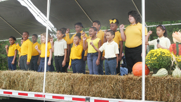 """A chorus of Aulander Elementary School children sang several original """"Peanut Songs"""" to serenade the crowd during the opening ceremonies on Saturday. Staff Photo by Gene Motley"""
