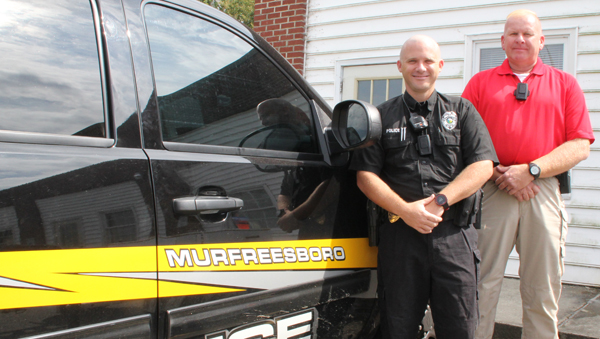 Sgt. David Griffith (left) and Lt. Joe Burgess are two of the eight Murfreesboro Police officers to add body cameras (shown on their upper chest) as part of the equipment they use on a daily basis. Staff Photo by Cal Bryant