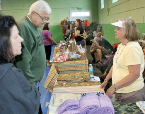 Festival-goers were treated to several dozen vendors who set up booths inside the old school gym.  Many of the merchants had local wares for sale and display. Staff Photo by Gene Motley