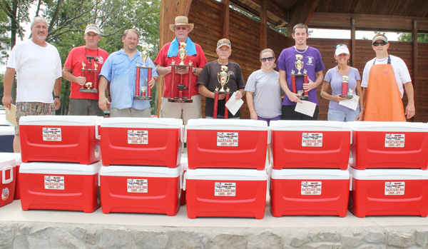 The winners from the annual Backyard BBQ Contest included the winner Charlie Meeks (center), Joe Peterson (fourth from left; 2nd place), Beach Boys BBQ (second and third from left; 3rd place), Tyler Whitley (third from right; 4th place), and Amy Whitley (second from right; 5th place). Trey Byrum (far left) and Chris Slachta (far right) directed the event. Staff Photo by Cal Bryant