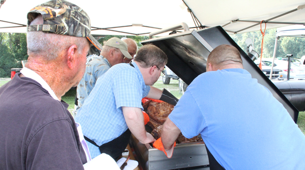 Charlie Meeks (left) of Newport watches as the judges go over his entry in the Backyard BBQ Contest, part of Saturday's Ahoskie Heritage Day. Meeks took home the first place trophy. Staff Photo by Cal Bryant